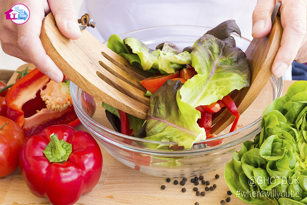 man-cooking-salad-branded-resized